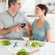 Stock Photo: Close up of cute couple toasting with redwine