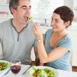 Woman feeding her boyfriend — Stock Photo