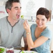 Stock Photo: Cute Womfeeding her boyfriend