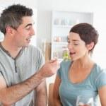 Man feeding his charming wife — Stock Photo