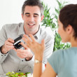 Stock Photo: Mproposing to his charming girlfriend during dinner