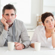Tired couple drinking coffee — Stock Photo #11189465