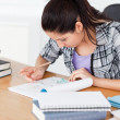 Young student doing homework — Stock Photo