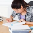 Stock Photo: Young student doing homework