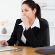 Serious young businesswoman in office — Stock Photo #11189874