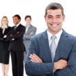 Businessman in front of colleagues — Stock Photo