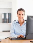 Working woman using a computer — Stock Photo