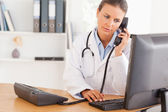Serious doctor on the phone — Stock Photo
