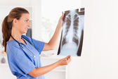 Good looking brunette doctor with stethoscope and x-ray — Stock Photo