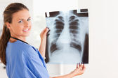 Brunette doctor with x-ray and stethoscope — Stock Photo