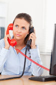 Businesswoman telephoning with two telephones — Stock Photo