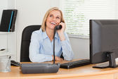 Cheerful businesswoman on phone looking at the ceiling — Stock Photo