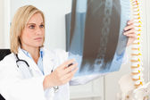 Serious doctor looking at x-ray — 图库照片