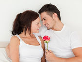 Delightful couple with a rose — Stock Photo