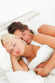 Couple hugging while sleeping — Stock Photo