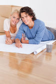 Portrait of a couple getting ready to move in a new house — Stock Photo