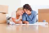 Happy couple organizing their new home — Stock Photo