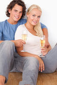 Portrait of a couple with glasses of sparkling wine — Stock Photo