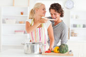 Woman making her fiance tasting her meal — Stock Photo