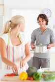 Portrait of a cute man bringing a boiler to her girlfriend — Stock Photo