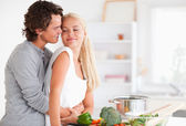 Cute couple hugging while cooking — Stock Photo