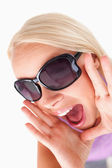 Blond lady with sunglasses in high spirits — Stock Photo