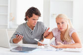 Clueless couple accounting — Stock Photo