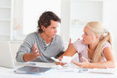 Couple arguing on expenses — Stock Photo