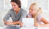 Happy couple doing paperwork — Stock Photo