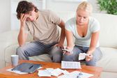 Stressed couple calculating their expenses — Stock Photo