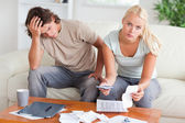 Worried couple calculating their expenses — Stock Photo
