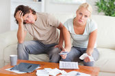 Worried couple calculating expenses — Stock Photo