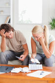 Calculating couple on a sofa — Stock Photo