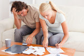 Worn out couple working together — Stock Photo