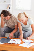 Despaired couple calculating their expenses — Stock Photo