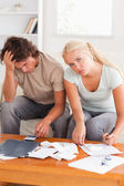 Despaired worn out couple calculating their expenses — Stock Photo