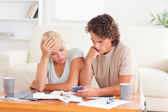 Calculating couple being despaired — Stock Photo