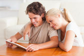 Happy couple with a tablet — Stock Photo