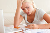 Worn out woman accounting — Stock Photo