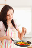 Woman holding frying pan — Stock Photo