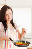 Woman frying vegetables — Stock Photo