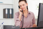 Telephoning businesswoman in office — Stock Photo