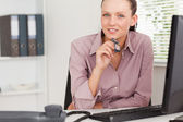 Businesswoman with glasses in office — Stock Photo