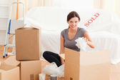 Charming woman packing her property — Stok fotoğraf