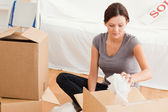 Young woman clearing out — Stock Photo