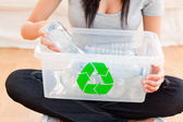 Woman with a recycling box — Stock Photo