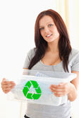 Gorgeous woman holding a recycling box — Stock Photo