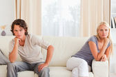 Upset couple sitting on a sofa — Foto Stock