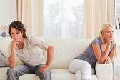 Upset couple sitting on a couch — Stock Photo