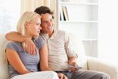 Cute couple watching TV — Stok fotoğraf